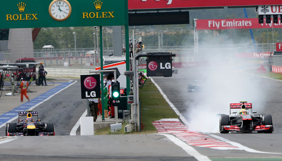 Sergio Perez locks a front tyre ahead of his delamination on the following straight