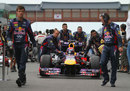 Sebastian Vettel is wheeled up the grid by his Red Bull team