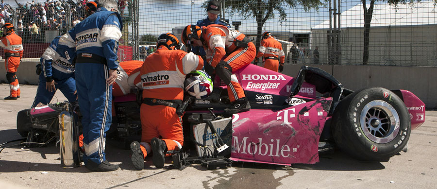 Marshals and medical workers remove Dario Franchitti from his crash