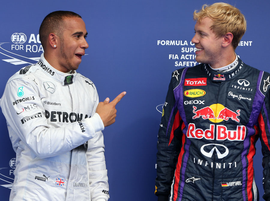 Sebastian Vettel and Lewis Hamilton share a joke