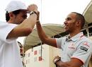 Lewis Hamilton shares a joke with Pedro de la Rosa