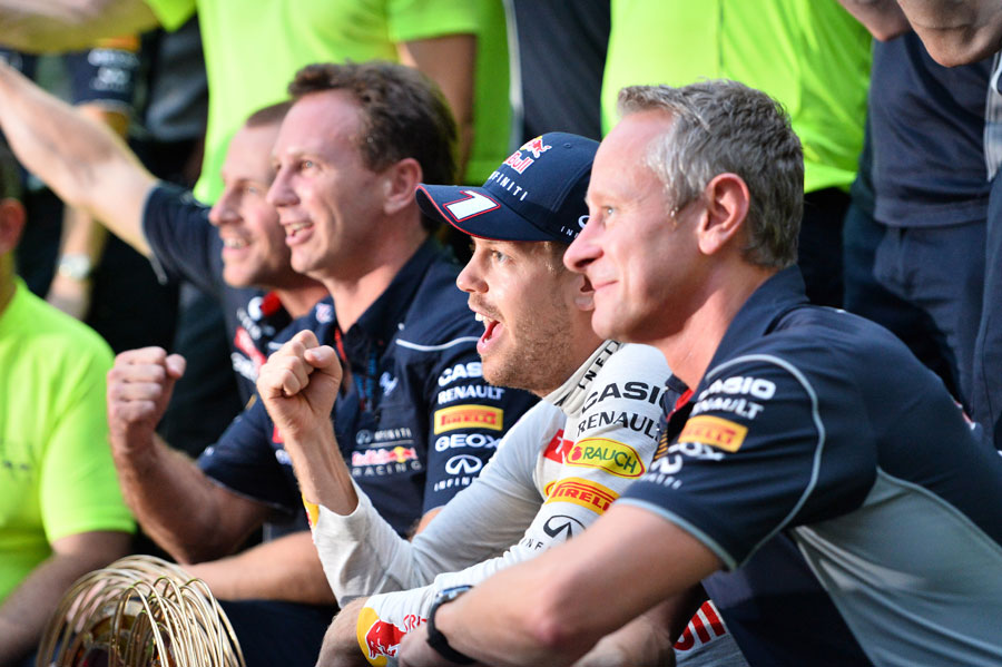 Sebastian Vettel celebrates victory with his team