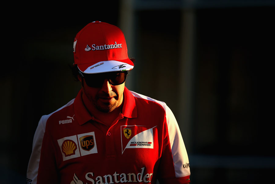 Fernando Alonso walks through the paddock
