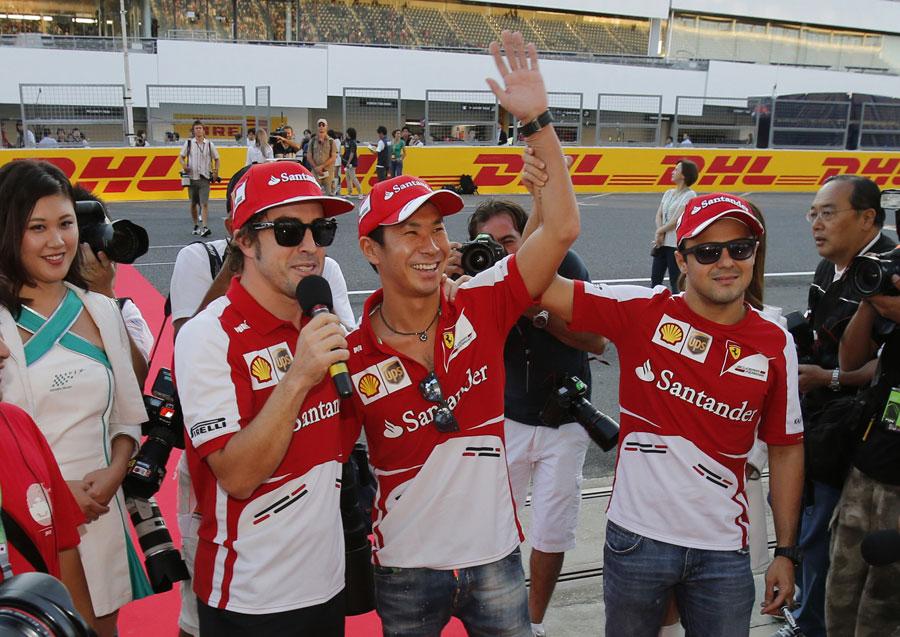 Ferrari's Fernando Alonso and Felipe Massa take Kamui Kobayashi out to meet the fans