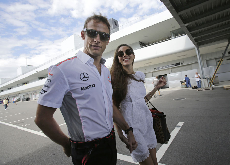 Jenson Button leaves the circuit with girlfriend Jessica Michibata