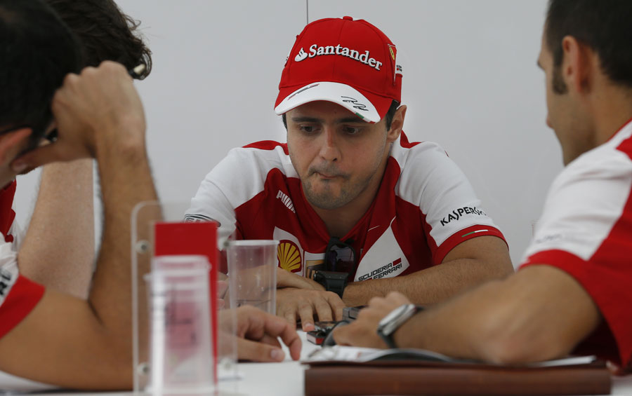 Felipe Massa in discussion with his Ferrari engineers
