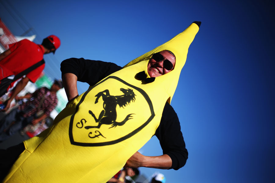 A Ferrari fan arrives dressed as a banana