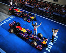 Sebastian Vettel celebrates as Mark Webber joins him in parc ferme
