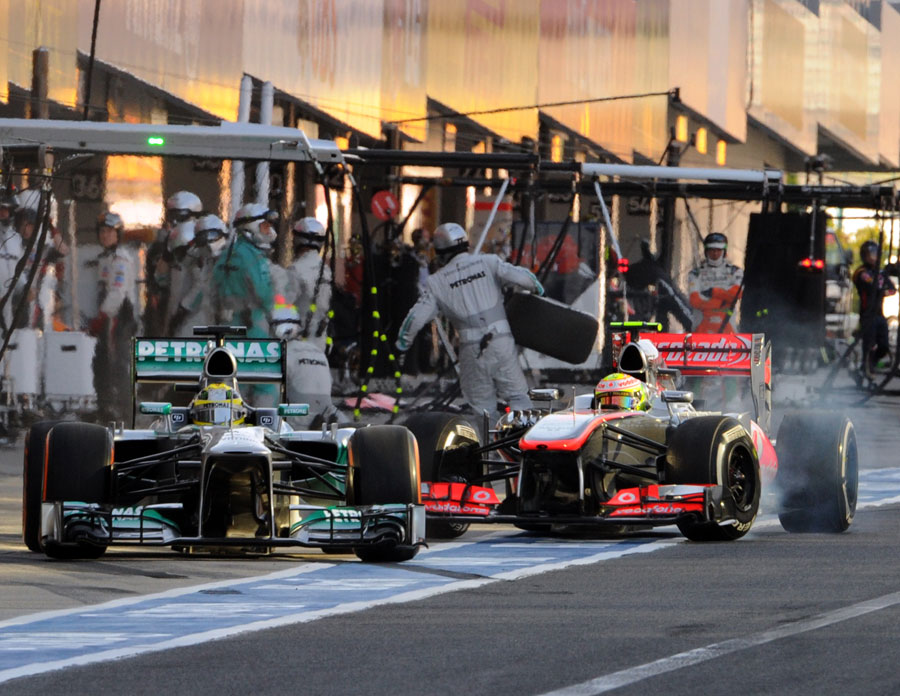 Sergio Perez takes avoiding action as Nico Rosberg is released into his path in the pits