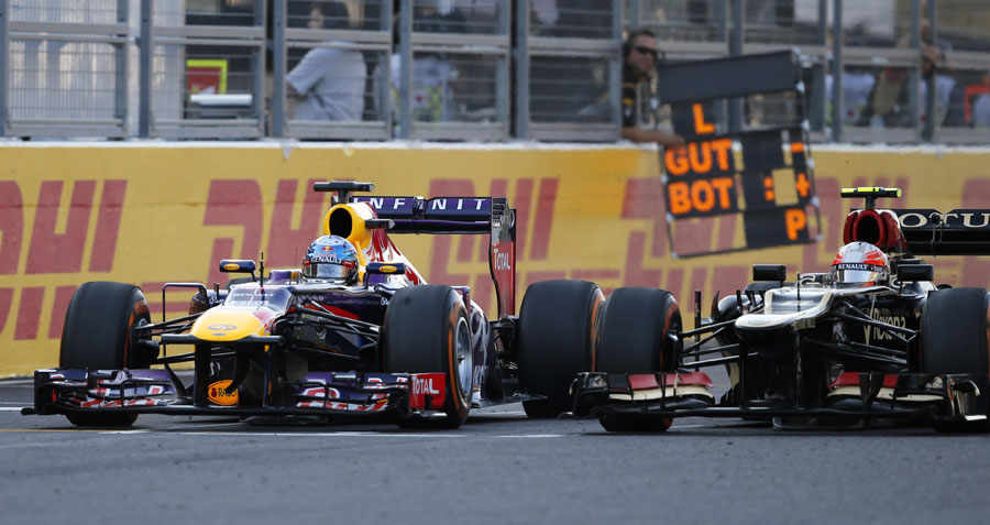 Sebastian Vettel finds his way past Romain Grosjean