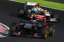Daniel Ricciardo leads Adrian Sutil on track