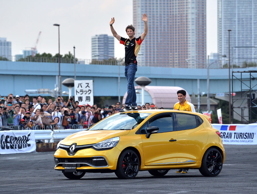 Romain Grosjean waves to the crowd at the Motor Sports Japan event