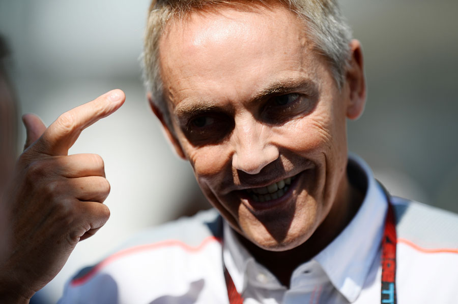 McLaren team principal Martin Whitmarsh in animated conversation