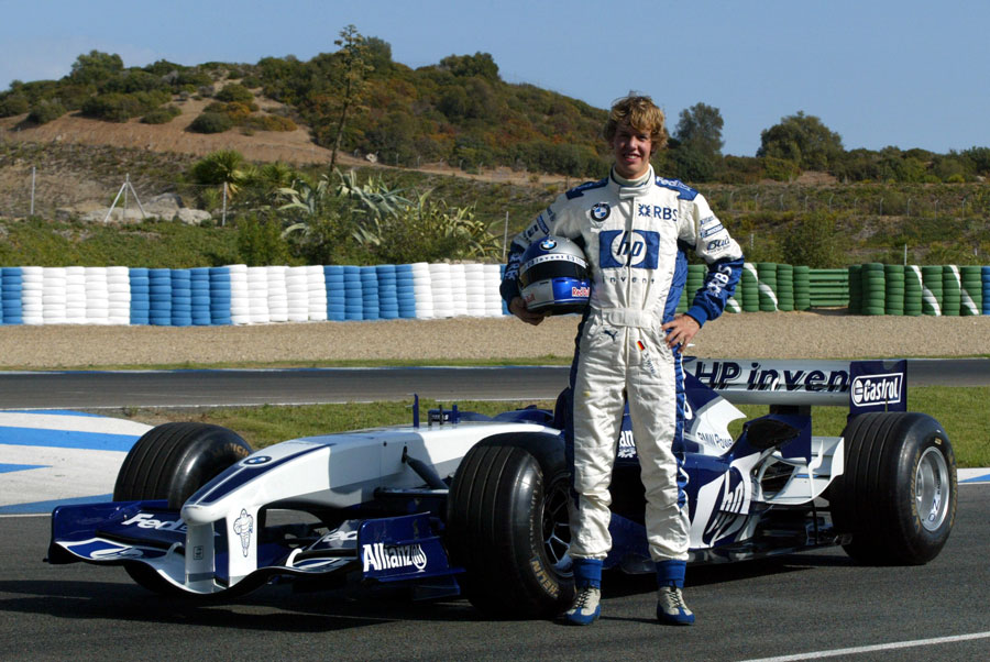 Sebastian Vettel poses ahead of his first test in a Formula One car