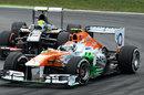 Adrian Sutil holds off Esteban Gutierrez