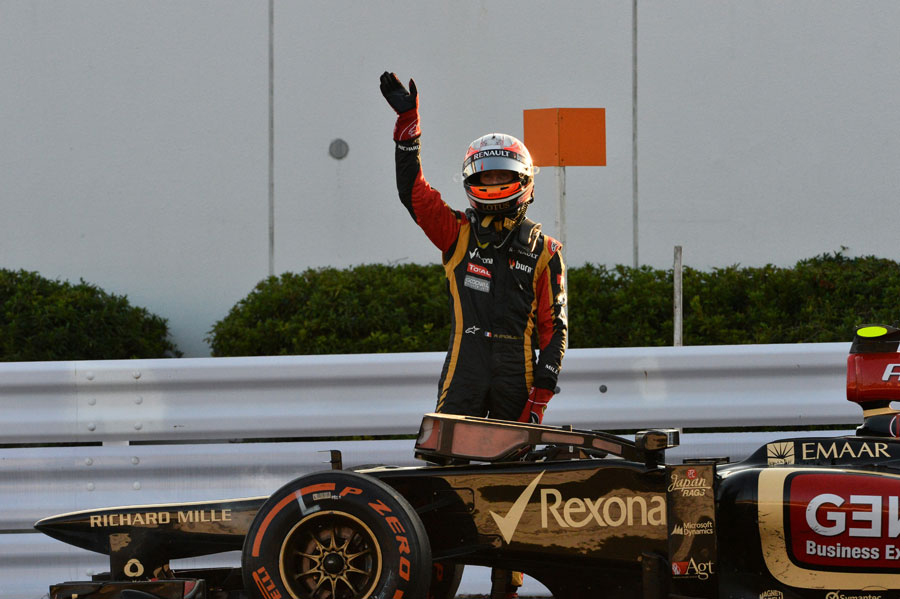 Romain Grosjean waves to the crowd after stopping on track after the race