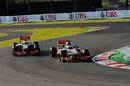Jenson Button leads Sergio Perez through the chicane