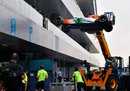 A Force India is lifted in to place in the paddock