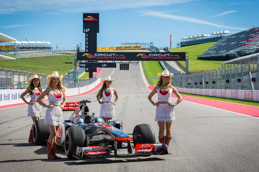 Texan girls pose with a McLaren MP4/26