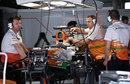 Force India mechanics work on Paul di Resta's car