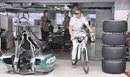 Nico Rosberg cycles out of the Mercedes garage