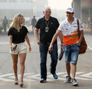 Adrian Sutil arrives at the circuit with girlfriend Jennifer Becks on Friday morning