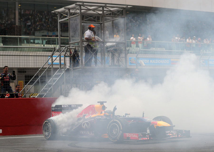 Sebastian Vettel celebrates his victory and fourth world championship