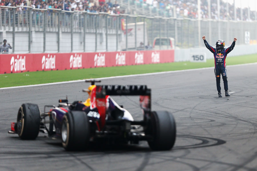 Sebastian Vettel celebrates his victory and fourth world championship