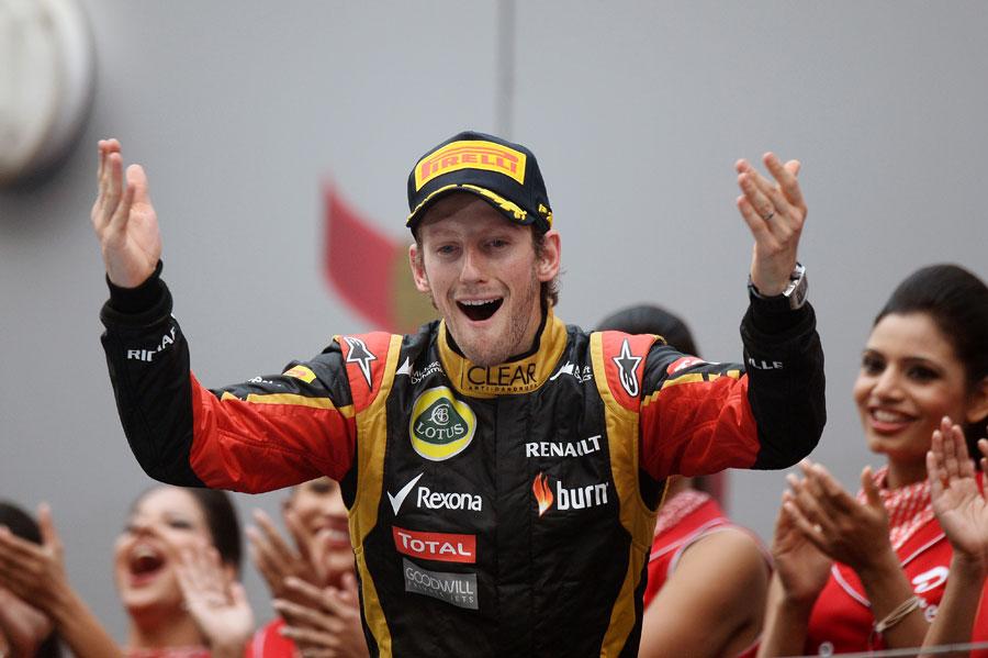 Romain Grosjean waves to the crowds