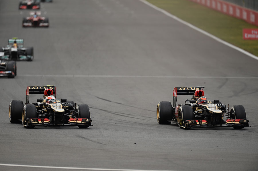 Romain Grosjean goes around the outside of Kimi Raikkonen heading into the final corner