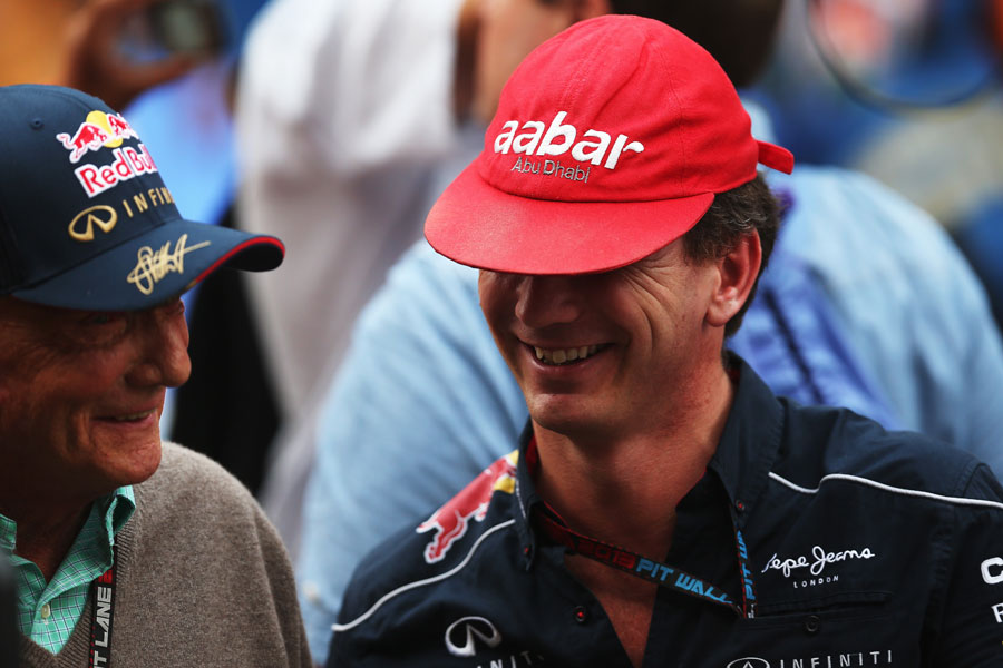 Niki Lauda and Christian Horner swap caps after the race