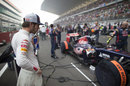 Jean-Eric Vergne inspects his car on the grid