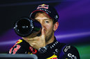 Sebastian Vettel swigs his champagne in the driver press conference