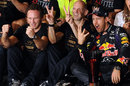 Sebastian Vettel, Adrian Newey and Christian Horner celebrate with the Red Bull team