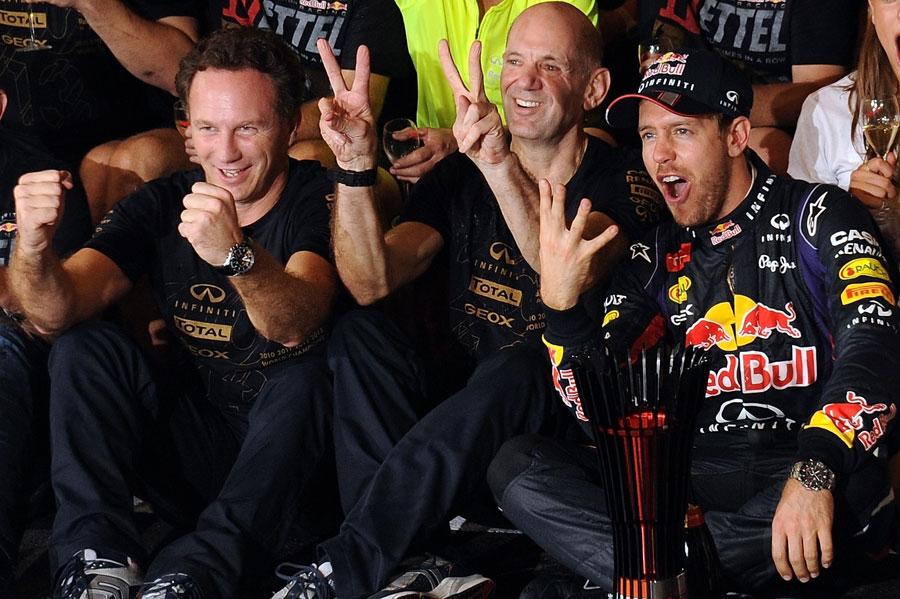 Sebastian Vettel, Adrian Newey and Christian Horner celebrate with the Red Bull team