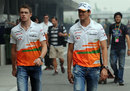 The two Force India drivers walk through the paddock