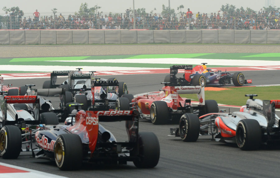 Sebastian Vettel leads the field in to the first corner