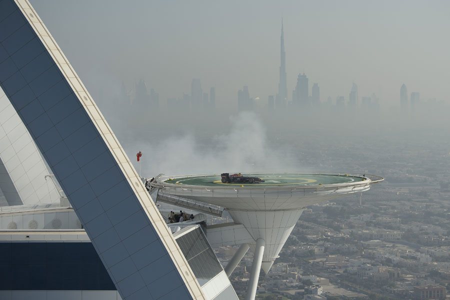 David Coulthard displays a Red Bull on top of the Burj Al Arab helipad