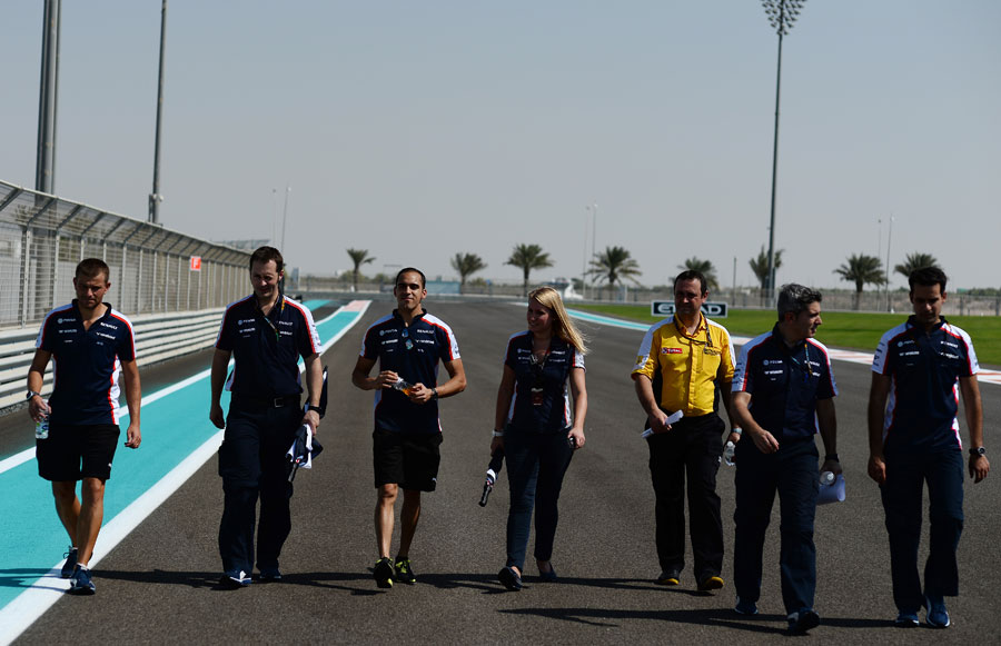 Pastor Maldonado walks the track with his Williams team ahead of the race weekend