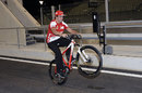 Fernando Alonso pulls a wheelie in the pit lane