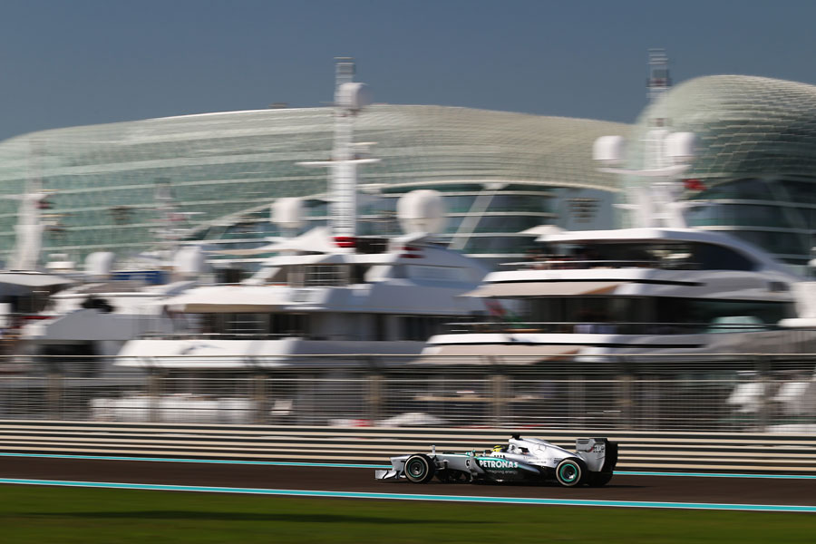 Nico Rosberg speeds past yachts in the marina
