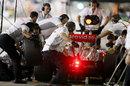 McLaren perform a practice pit stop