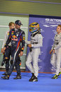 Lewis Hamilton congratulates Mark Webber on pole position