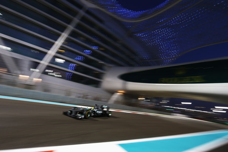 Nico Rosberg passes under the Yas Hotel