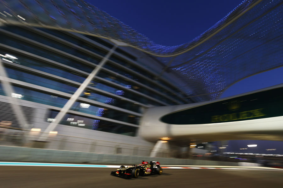 Kimi Raikkonen passes under the Yas Hotel