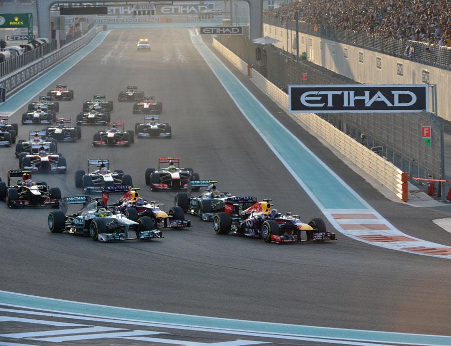 Sebastian Vettel leads the field into the first corner