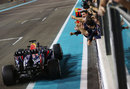 Sebastian Vettel celebrates as he crosses the line with his Red Bull team
