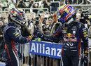Mark Webber congratulates Sebastian Vettel in parc ferme