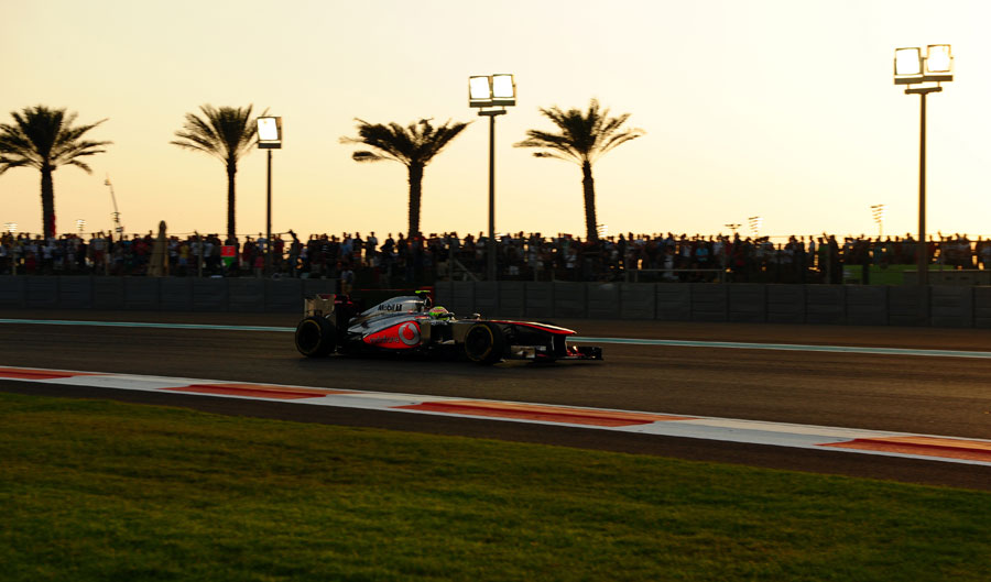 Sergio Perez on track as the sun begins to set