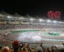 Sebastian Vettel entertains the fans as fireworks mark his victory